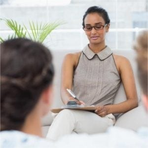 Diploma in Psychology & Counselling - Young Professional Counsellor taking notes