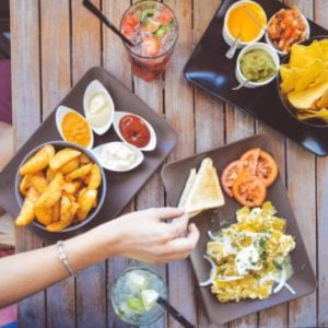 Diploma in Hospitality & Tourism - Person having snack food