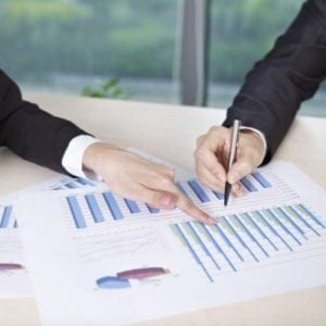 Diploma in Business - Business Professionals looking at spreadsheets