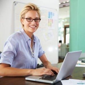 Diploma in Payroll - Professional Woman on Laptop at an office